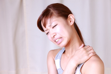 japanese woman woman suffers from stiff neck