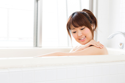 beautiful asian woman relaxing in the bath room